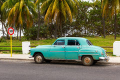 Green vintage car in Cuba Stock Photo