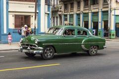 Green vintage Chevrolet taxi Havana Royalty Free Stock Photos