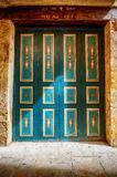 Green vintage door spotlit by sunlight Stock Photo