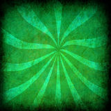 Green vintage grunge background with sun rays Royalty Free Stock Photo