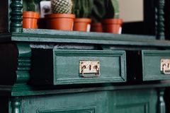 Green Vintage old chest of drawers with open empty drawers. Royalty Free Stock Photos