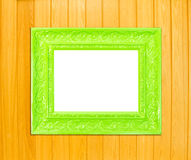 Green Vintage picture frame on wood background Stock Image