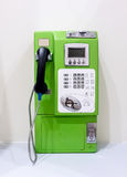 Green vintage public pay phone Royalty Free Stock Image