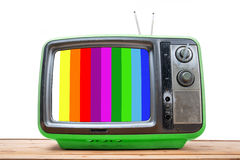 Green Vintage TV on wood table Royalty Free Stock Photos