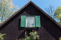 Green vintage window of old wooden house Stock Photo