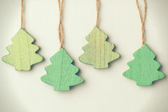 Green vintage wooden christmas trees hanging on string Royalty Free Stock Photos