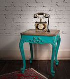 Green vintage wooden table and old golden telephone set Royalty Free Stock Photo