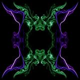 Green and violet abstract twisted smoke formed in circles, isolated on black background stock photo