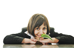 Green vision. Young business woman isolated on white holding green plant with small leaf and waiting to grow stock images