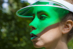 Green Visor. Young attractive lady with a green visor Stock Images