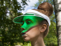 Green Visor. Young attractive lady wearing a green visor Royalty Free Stock Photo