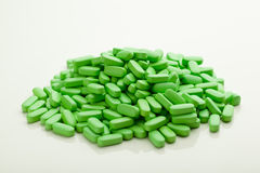 Green vitamin pills Stock Images