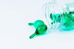 Green vitamins Stock Images