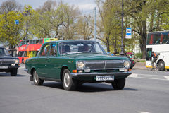 Green Volga of GAZ-24 of 1971 of release participates in the III St. Petersburg parade of retrotransport. ST. PETERSBURG, RUSSIA - MAY 21, 2017: Green Volga of Stock Photos