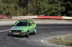 Green Volkswagen in a curve. Paltinis, Sibiu, Romania - September 23, 2012: Coastal Race Rally on the road to Paltinis Royalty Free Stock Photo