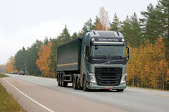 Green Volvo FH Semi Truck on the Road in Autumn Royalty Free Stock Images