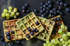 Green Waffles With Grapes Stock Photography