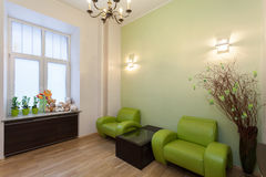 Green waiting room. Waiting room with green furniture and toys Stock Photos