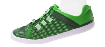 Green walking sport shoes on white royalty free stock photography