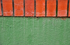 Green wall with bricks Royalty Free Stock Photo