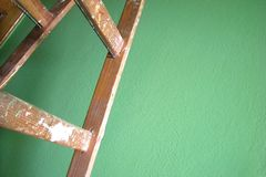 Green wall and ladder. Painting house Royalty Free Stock Images