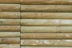 Green wall made with wooden logs, horizontal lines.  royalty free stock photo
