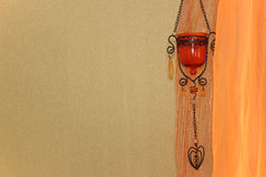 Green wall, orange curtain and oriental decor element Stock Photos
