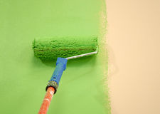 Green wall painting roller Royalty Free Stock Images