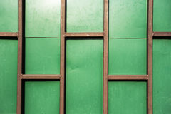 Green wall with rust metal Royalty Free Stock Image