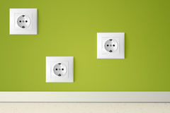 Green wall with three european electric outlets Royalty Free Stock Photo