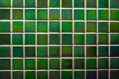 Green wall tiles as a background image royalty free stock photo