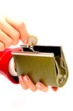 Green wallet and coin in woman hand Royalty Free Stock Image