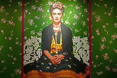 Green wallpaper image in the Frida Kahlo exhibition. Frida Kahlo exhibition. Budapest Hungary in the autumn of 2018. Masterpieces from the Museum Dolores Olmedo stock image