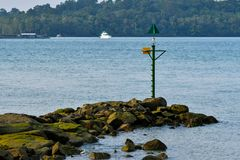 Green warning sea mark. A sea mark, also seamark and navigation mark, is a form of aid to navigation and pilotage that identifies the approximate position of a royalty free stock photography