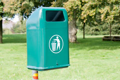 Green waste bin in a park Royalty Free Stock Image