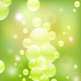 Green water bubbles. Glowing transparent water bubbles on a green background Royalty Free Stock Photo