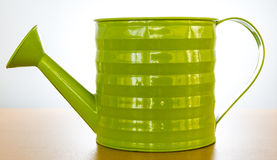 Green water can. On white background Stock Image