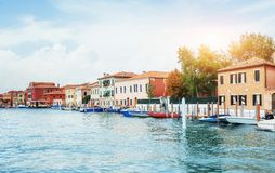 Green water channel with gondolas and colorful facades of old me Royalty Free Stock Photography