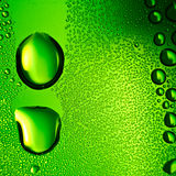 Green water drops background. Royalty Free Stock Images