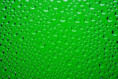 Green water drops background stock images