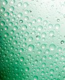 Green water drops background.close up of Royalty Free Stock Photography