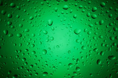 Green water drops on glass surface Royalty Free Stock Images