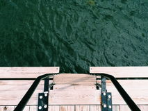 Green water front of wood stairs Stock Image
