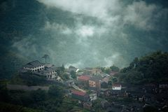 Some ancient villages in Anhui, China, are no longer occupied. They are empty houses. Between the green water and the green hills, in the misty mountains, these stock photos