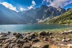 Green water mountain lake Morskie Oko, Tatra Mountains, Poland Stock Photos