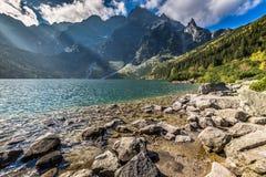 Green water mountain lake Morskie Oko, Tatra Mountains, Poland Royalty Free Stock Photos