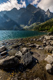 Green water mountain lake Morskie Oko, Tatra Mountains, Poland Royalty Free Stock Photo