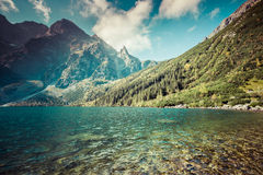 Green water mountain lake Morskie Oko, Tatra Mountains, Poland Stock Images