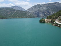 Green water. Nearby mountains in Turkey Royalty Free Stock Image