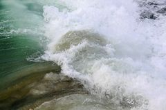 Green water of Pacific ocean. Waves and storm. Stock Photos